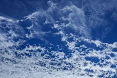 blue sky background with tiny clouds royalty free stock photo