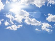Blue sky background with tiny clouds stock photos