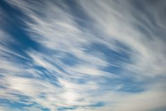 Blue sky background with tiny stratus cirrus striped clouds. Clearing day and Good windy weather.  stock photos