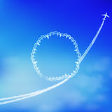 Blue sky background with trace of an airplane. Stock Photos