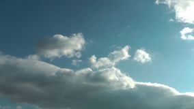 Blue sky background with white clouds. Blue sky background with white cumulus clouds stock video footage