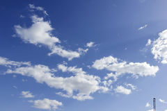Blue sky background with white clouds. Fluffy cloud on clear blue sky background, pure air on a good day royalty free stock photography