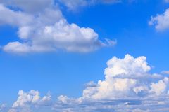 Blue sky background with white clouds, rain clouds on sunny summer or spring day.  Royalty Free Stock Photography