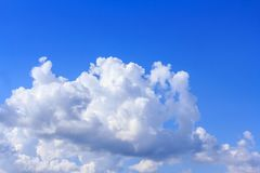Blue sky background with white clouds, rain clouds on sunny summer or spring day.  Stock Photo