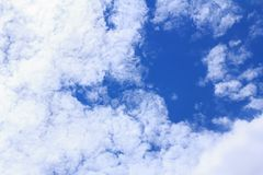 Blue sky background with white clouds, rain clouds on sunny summer or spring day.  Royalty Free Stock Images