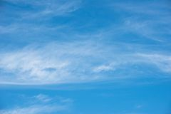 Blue sky background with white clouds Stock Image
