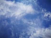 Blue sky background and white clouds soft focus. And copy space stock image