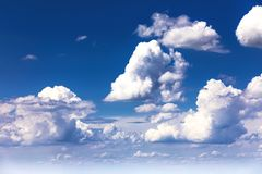 Blue sky background with white cumulus clouds. Beautiful blue sky background with sparced white cumulus clouds, nature, color, summer, light, bright, high royalty free stock photos