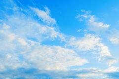 Blue sky background with white dramatic colorful fluffy clouds and sunlight. Beautiful sky landscape scene, panoramic view royalty free stock images