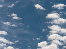 Blue sky background and white fluffy clouds. Blue sky background with white fluffy clouds stock image