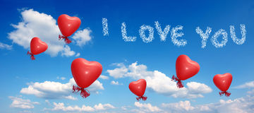 Blue sky with balloon hearts and love you message. Blue sky with red balloon hearts and I love you message Stock Photos