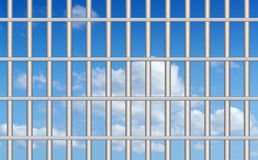 Blue sky through the bars Stock Images