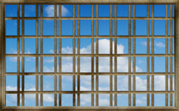 Blue sky through the bars Royalty Free Stock Photo