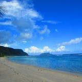Blue sky and the beach in the tropical island Samoa. Beach with white sand in the tropical island of Samoa Stock Photos