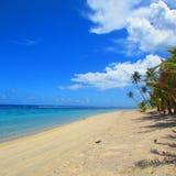 Blue sky and the beach in the tropical island Samoa. Blue sky and white sandy beach in the tropical island Samoa Royalty Free Stock Photos