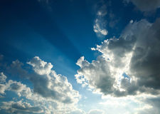 Blue sky in beams sunshine Royalty Free Stock Photos