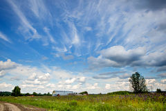 Blue sky with beautiful bizarre clouds in the countryside Stock Image