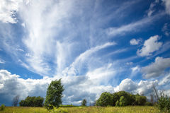 Blue sky with beautiful bizarre clouds in the countryside Royalty Free Stock Image