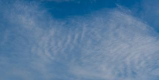 Cirrus Clouds on a Blue Sky. A blue sky with beautiful Cirrus clouds is displayed in this image royalty free stock image