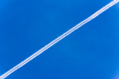Blue sky. Beautiful blue summer sky with white lines Royalty Free Stock Photos