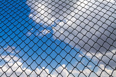 Blue sky behind the barbed wire - fence Stock Photos