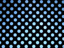 Blue sky behind pattern of circles Royalty Free Stock Photography