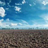 Blue sky and black agriculture field. Deep blue sky with clouds and black agriculture field Stock Photography