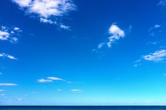 Blue sky and blue ocean horizon Stock Photo