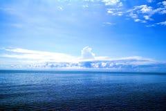 Blue sky, blue ocean. Very blue sky with nice cloud, blue ocean, peaceful life Royalty Free Stock Images