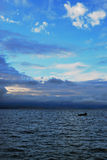 Blue sky and blue sea of Erhai Lake. This photo was taken in Erhai Lake. Dali city Yunnan province.  The sky is in deep blue and connect to the lake so close Royalty Free Stock Photos