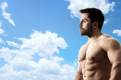 Blue sky bodybuilder Stock Images