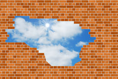 Blue sky through brick wall Royalty Free Stock Photography