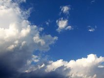 Blue Sky. Bright blue summer sky with clouds royalty free stock photo