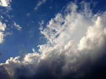Blue Sky. Bright blue summer sky with clouds stock photo