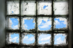 Blue sky through the broken window Royalty Free Stock Photography
