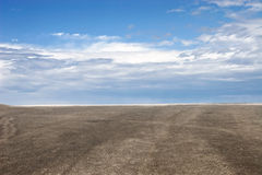 Blue sky and brown ground Royalty Free Stock Photo