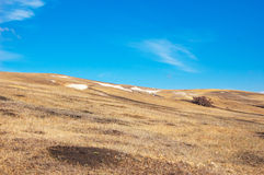 Blue sky, brown slope Stock Images
