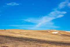 Blue sky, brown slope Royalty Free Stock Image