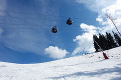 Blue sky and cabines of lift. Stock Image