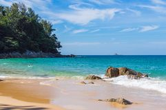 Blue sky and calm sea on Naithon Noi beach in Phuket Thailand.  Stock Images
