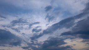 Blue sky changes, dark gray rain clouds tighten. Time lapse. Blue sky changes, dark gray rain clouds tighten, natural variability, sunny weather changes to stock video