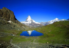 Blue sky, clear view of Matterhorn reflection in summer lake Royalty Free Stock Images