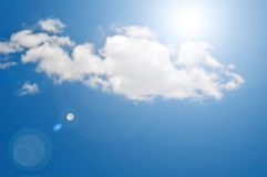 Blue sky & cloud. Artificial lens flare on blue sky background.,synthetic of lens flare on sky background Royalty Free Stock Photos