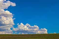 Blue sky and cloud with bright sun above ground star flare background stock photos