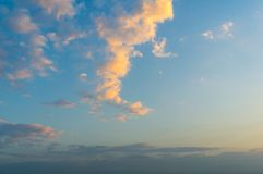 Blue sky and cloud with golden rim ligh. T in early morning Royalty Free Stock Image