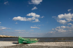 Blue sky cloud green boat Royalty Free Stock Image