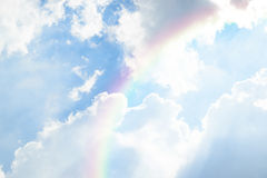 Blue sky cloud with rainbow. Nature cloudscape with blue sky and white cloud with rainbow Stock Photography