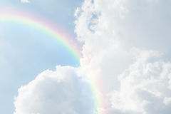 Blue sky cloud with rainbow. Nature cloudscape with blue sky and white cloud with rainbow Stock Images