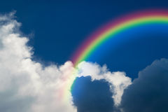 Blue sky cloud with rainbow. Nature cloudscape with blue sky and white cloud with rainbow Royalty Free Stock Images