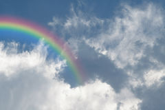 Blue sky cloud with rainbow. Nature cloudscape with blue sky and white cloud with rainbow Royalty Free Stock Image